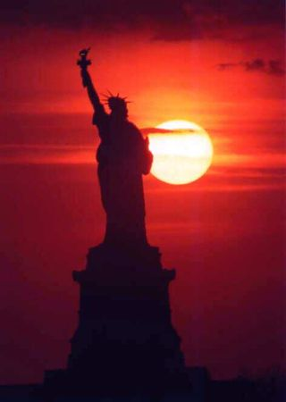 Statue of Liberty silhouette with fire red sky